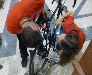 Will Caldwell and Katie Miller prepare the Safe Cycle device for the Internet of Things Open House on Dec. 11. Safe Cycle is designed to alert a bicycle rider to traffic behind the bike. Photo: David Tenenbaum/University of Wisconsin-Madison